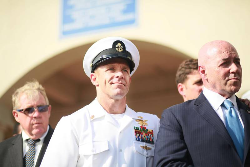 SAN DIEGO, CA - JULY 02:R, Navy Special Operations Chief Edward Gallagher celebrates after being acquitted of premeditated murder at Naval Base San Diego July 2, 2019 in San Diego, California. Gallagher was found not guilty in the killing of a wounded Islamic State captive in Iraq in 2017. He was cleared of all charges but one of posing for photos with the dead body of the captive.   Sandy Huffaker/Getty Images/AFP