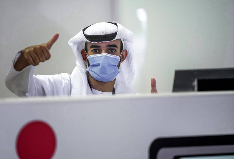 Abu Dhabi, United Arab Emirates, May 6, 2020. the new Ambulatory Healthcare Services, a SEHA Health System Facility, National Screening Project in Mussafah Industrial Area in Abu Dhabi.  --  A testing center staffer gives the thumbs up sign.Victor Besa / The NationalSection:  NAReporter:  Nick Webster