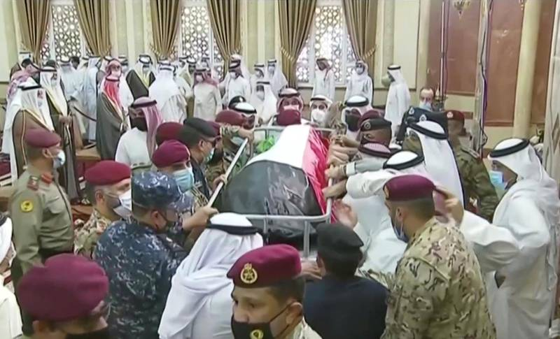People carry the body of the late Emir Sheikh Sabah al-Ahmad al-Sabah after funeral prayers in Kuwait City, Kuwait, September 30, 2020, in this still image taken from a video. Kuwait TV/Handout via REUTERS ATTENTION EDITORS - THIS IMAGE WAS PROVIDED BY A THIRD PARTY. NO RESALES. NO ARCHIVES KUWAIT OUT. NO COMMERCIAL OR EDITORIAL SALES IN KUWAIT