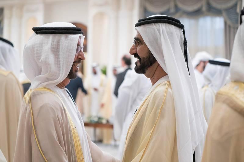 ABU DHABI, UNITED ARAB EMIRATES - August 21, 2018: HH Sheikh Mohamed bin Rashid Al Maktoum, Vice-President, Prime Minister of the UAE, Ruler of Dubai and Minister of Defence (R) and HE Hamad bin Suhail Al Khaili (L) attend an Eid Al Adha reception at Mushrif Palace.  ( Mohamed Al Hammadi / Crown Prince Court - Abu Dhabi ) ---