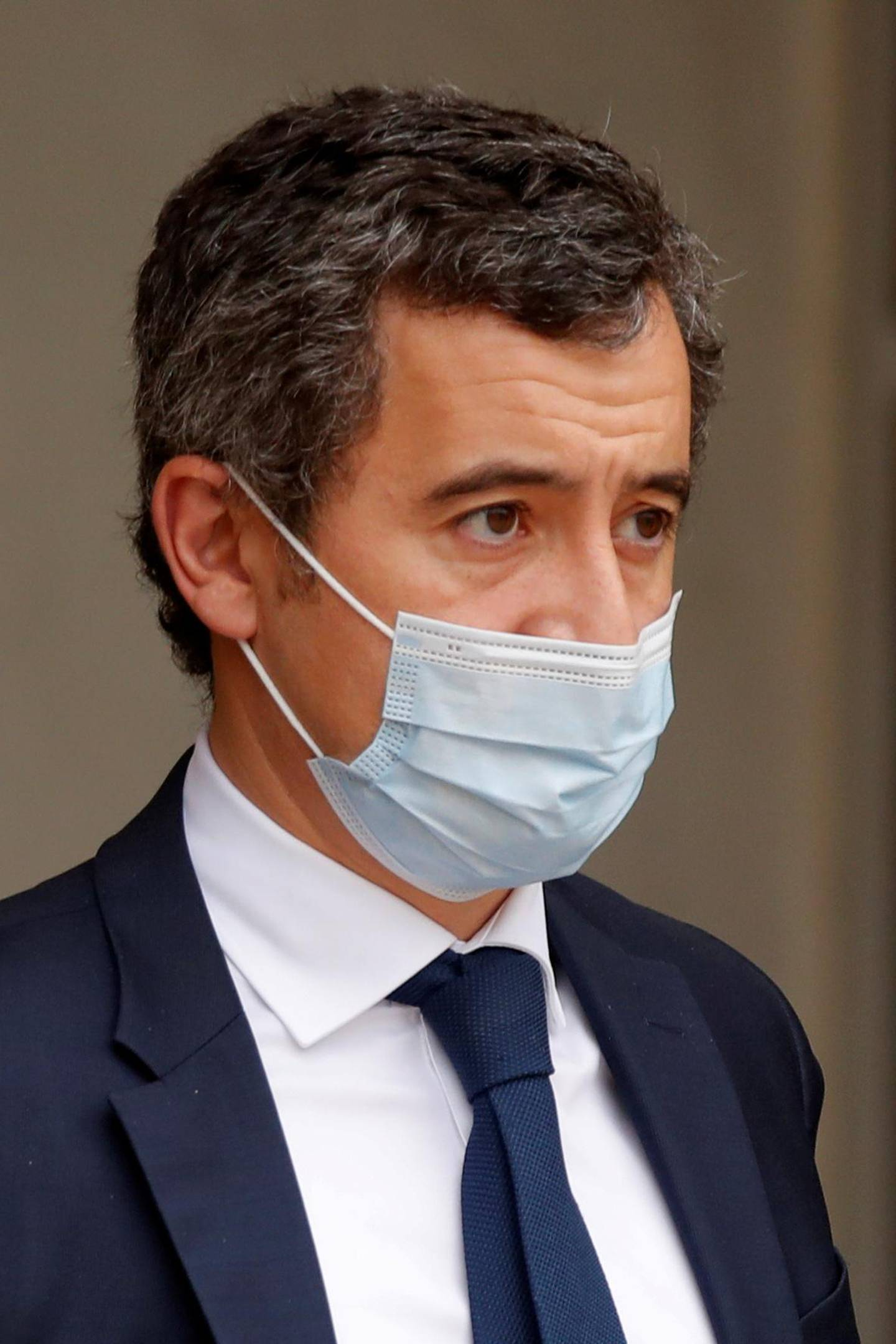 FILE PHOTO: French Interior Minister Gerald Darmanin, wearing a protective face mask, leaves after the weekly cabinet meeting at the Elysee Palace in Paris, France, November 25, 2020. REUTERS/Charles Platiau/File Photo