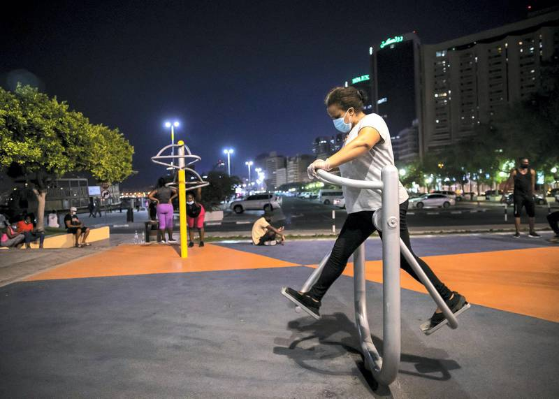 DUBAI, UNITED ARAB EMIRATES. 2 JUNE 2020. A woman exercising in a park by Dubai Creek in Baniyas, Deira.(Photo: Reem Mohammed/The National)Reporter:Section: