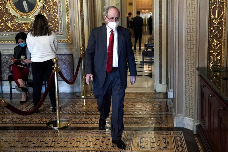 Sen. Jim Risch, R-Idaho, walks on Capitol Hill during the fifth day of the second impeachment trial of former President Trump, Saturday, Feb. 13, 2021 at the Capitol in Washington. (Greg Nash/Pool via AP)