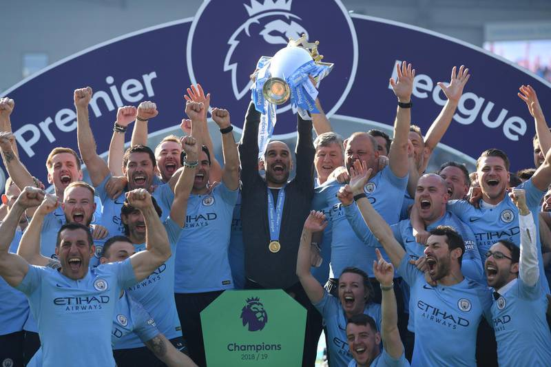 BRIGHTON, ENGLAND - MAY 12: Josep Guardiola,Manager of Manchester City lifts the Premier League Trophy after winning the title during the Premier League match between Brighton & Hove Albion and Manchester City at American Express Community Stadium on May 12, 2019 in Brighton, United Kingdom. (Photo by Mike Hewitt/Getty Images)