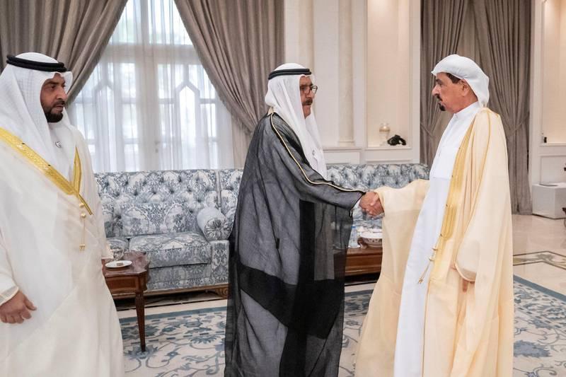 ABU DHABI, UNITED ARAB EMIRATES - August 11, 2019: HH Sheikh Hamdan bin Rashid Al Maktoum, Deputy Ruler of Dubai and UAE Minister of Finance (C), greets HH Sheikh Humaid bin Rashid Al Nuaimi, UAE Supreme Council Member and Ruler of Ajman (R), during  an Eid Al Adha reception at Mushrif Palace. Seen with HH Sheikh Hamdan bin Zayed Al Nahyan, Ruler's Representative in Al Dhafra Region (L).  ( Eissa Al Hammadi / Ministry of Presidential Affairs ) ---