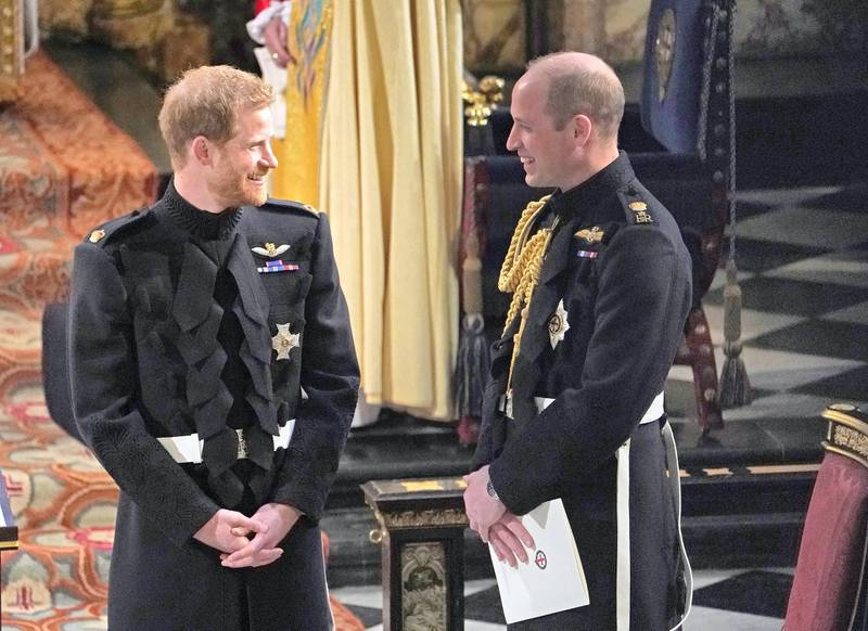 WINDSOR, ENGLAND - MAY 19: Prince Harry with his Best Man, the Duke of Cambridge wait for the start of his wedding ceremony to Meghan Markle at  St George's Chapel at Windsor Castle on May 19, 2018 in Windsor, England. (Photo by Owen Humphreys - WPA Pool/Getty Images)
