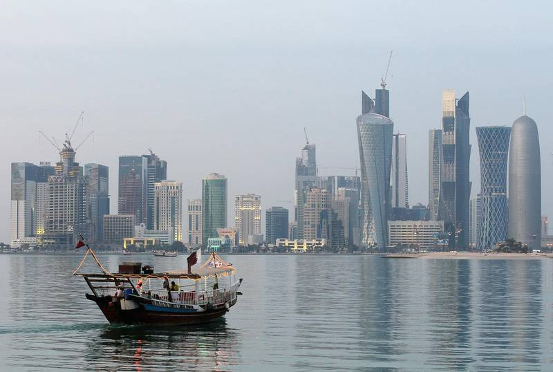 DOHA, QATAR - JANUARY 04:  View of the skyline of the West Bay area in Doha with a dhau boat is taken on January 4, 2011 in Doha, Qatar. The International Monetary Fund (IMF) recently reiterated its projection for the Qatari economy with predictions of double digit growth for 2010 and 2011. Though natural gas and petroleum production are still the biggest two single sources of income, the non-energy sector overtook oil and gas in Qatari GDP for 2009. Qatar is heavily dependant on foreign labour from countries such as India, Sri Lanka, Bangladesh, the Phillipines and other Arab countries. Foreigners make up approximately two thirds of the Qatari population. The FIFA world cup 2022 will takes place in Qatar.  (Photo by Christof Koepsel/Getty Images)