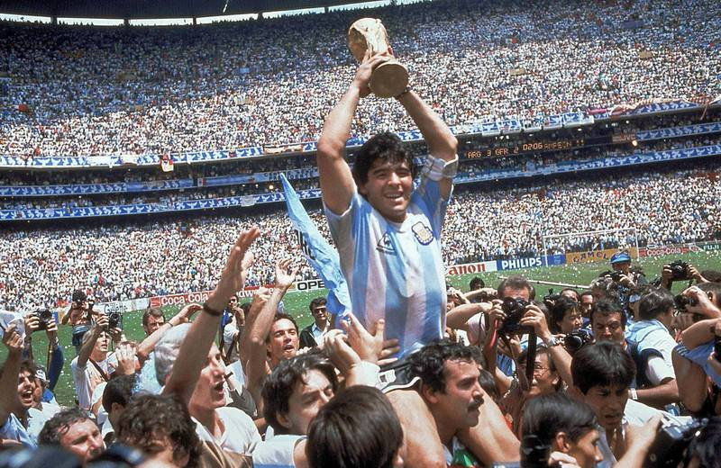 Mandatory Credit: Photo by Carlo Fumagalli/AP/Shutterstock (7377234a) Diego Maradona Diego Maradona, holds up the trophy, after Argentina beat West Germany 3-2 in their World Cup soccer final match, at the Atzeca Stadium, in Mexico City. On this day: Maradona leads Argentina to its second World Cup triumph Soccer WCup On This Day, Mexico City, Mexico