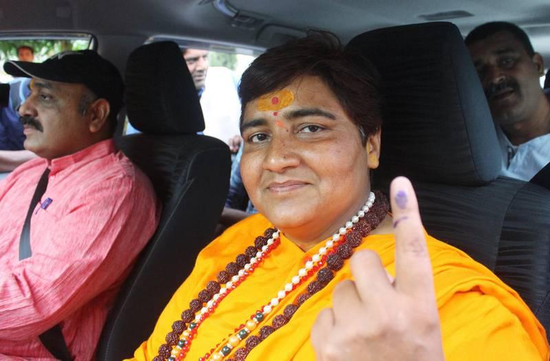 Pragya Singh Thakur, leader of ruling Bharatiya Janata Party (BJP), shows her ink-marked finger after casting her vote, outside a polling station in Bhopal, India, May 12, 2019. REUTERS/Raj Patidar