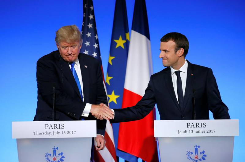 French President Emmanuel Macron (R) and U.S. President Donald Trumps shake hands as they attend a joint news conference at the Elysee Palace in Paris, France, July 13, 2017.   REUTERS/Gonzalo Fuentes