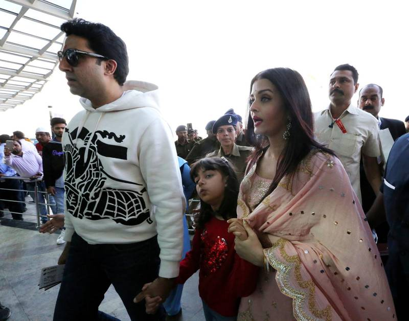 epa08219400 Bollywood actor Abhishek Bachchan (L) with his wife and Bollywood actress Aishwarya Rai Bachchan   at Raja Bhoj airport in Bhopal, India, 15 February 2020. The couple was  on a personal visit to city  EPA-EFE/SANJEEV GUPTA