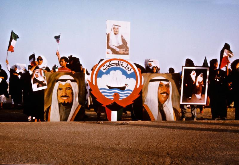 A demonstration in Kuwait, following the country's invasion by Iraq at the start of the Gulf War, 4th-6th August 1990. In the centre is the Emblem of Kuwait, adopted in 1962. (Photo by Derek Hudson/Getty Images)