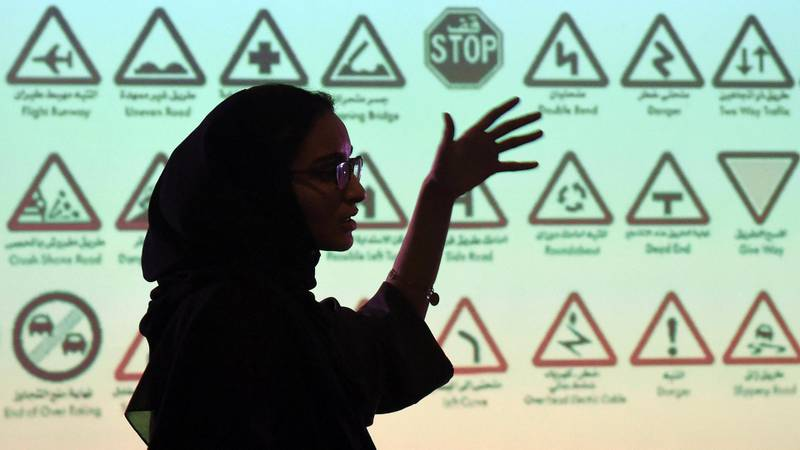 """An employee of Careem, a chauffeur driven car booking service, talks during a training session for new female drivers, known in the company as """"captains"""" at their Saudi offices in Khobar City, some 424 kilometres east of the Saudi capital of Riyadh, on October 10, 2017.  Saudi Arabia's decision to allow women to drive had some sounding the death knell for ride-hailing apps like Careem, but its co-founder expects business to flourish and even plans to hire thousands of female drivers. / AFP PHOTO / FAYEZ NURELDINE"""
