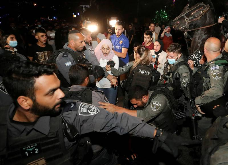 Prominent Palestinian activist Muna El-Kurd reacts during scuffles with Israeli police amid ongoing tension ahead of an upcoming court hearing in an Israeli-Palestinian land-ownership dispute in the Sheikh Jarrah neighbourhood of East Jerusalem, May 4, 2021. REUTERS/Ammar Awad