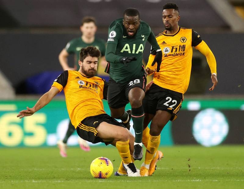 Soccer Football - Premier League - Wolverhampton Wanderers v Tottenham Hotspur - Molineux Stadium, Wolverhampton, Britain - December 27, 2020 Tottenham Hotspur's Tanguy Ndombele in action with Wolverhampton Wanderers' Ruben Neves and Nelson Semedo Pool via REUTERS/Carl Recine EDITORIAL USE ONLY. No use with unauthorized audio, video, data, fixture lists, club/league logos or 'live' services. Online in-match use limited to 75 images, no video emulation. No use in betting, games or single club /league/player publications.  Please contact your account representative for further details.     TPX IMAGES OF THE DAY
