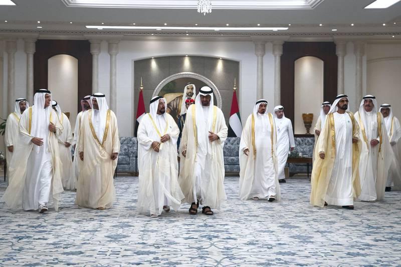 ABU DHABI, UNITED ARAB EMIRATES - August 21, 2018:  HH Sheikh Saud bin Saqr Al Qasimi, UAE Supreme Council Member and Ruler of Ras Al Khaimah (L), HH Sheikh Hamad bin Mohamed Al Sharqi, UAE Supreme Council Member and Ruler of Fujairah (2nd L), HH Dr Sheikh Sultan bin Mohamed Al Qasimi, UAE Supreme Council Member and Ruler of Sharjah (3rd L), HH Sheikh Mohamed bin Zayed Al Nahyan, Crown Prince of Abu Dhabi and Deputy Supreme Commander of the UAE Armed Forces (4th L), HH Sheikh Humaid bin Rashid Al Nuaimi, UAE Supreme Council Member and Ruler of Ajman (5th L), HH Sheikh Mohamed bin Rashid Al Maktoum, Vice-President, Prime Minister of the UAE, Ruler of Dubai and Minister of Defence (6th L) and HH Sheikh Saud bin Rashid Al Mu'alla, UAE Supreme Council Member and Ruler of Umm Al Quwain (R).    Eid Al Adha reception at Mushrif Palace.    ( Hamad Al Kaabi / Crown Prince Court - Abu Dhabi ) ---