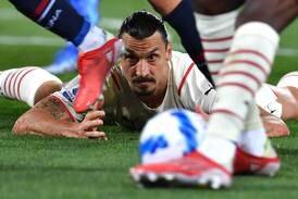 Ibrahimovic scores at both ends as AC Milan beat nine-man Bologna