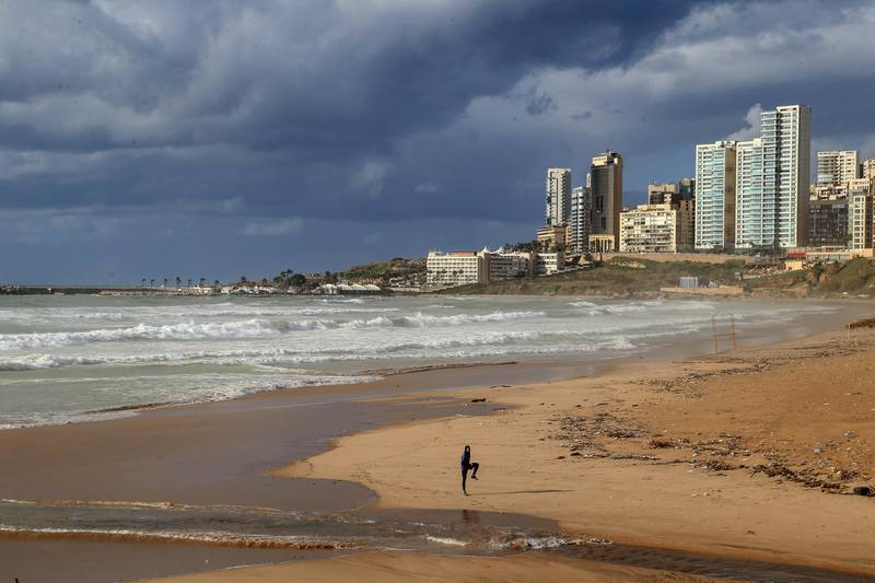 epa08946047 A man practices on a beach of Ramlet Al-Bayda area in Beirut, Lebanon, 18 January 2021. Lebanon on 07 January began a complete 25-day closure nationwide, before announcing a comprehensive closure from 14 January with no exceptions but the health, security and press sectors to help stop the spread of the Coronavirus.  EPA-EFE/NABIL MOUNZER