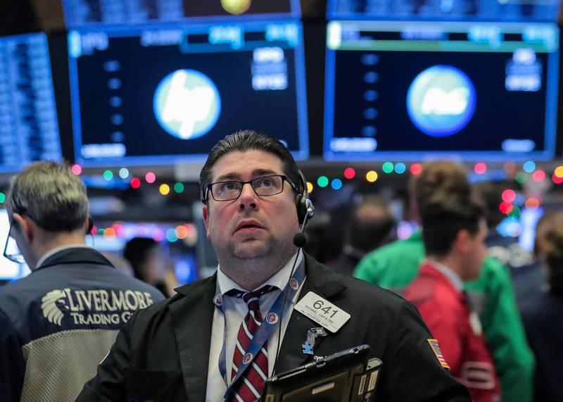 Traders work on the floor of the New York Stock Exchange (NYSE) in New York, U.S., December 7, 2018. REUTERS/Brendan McDermid