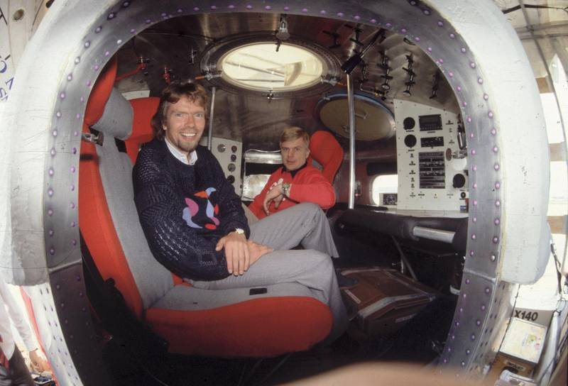 16th June 1987:  Tycoon Richard Branson in the cabin of the Virgin balloon, 'Virgin Atlantic Flyer' at Gatwick airport before it was taken to its starting point in Bangor, Sussex for its record Atlantic crossing.  (Photo by Hulton Archive/Getty Images)