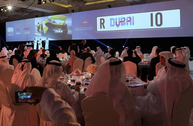 Dubai, United Arab Emirates- June, 21, 2016 :Bidders bid for the Number Plate 10 at the Reading Nation Auction at the Madinat Jumeirah in Dubai  . ( Satish Kumar / The National  )  ID No: 43369 Section: News Reporter : Dana  Moukhallati *** Local Caption ***  SK-Auction-21062016-010.jpg