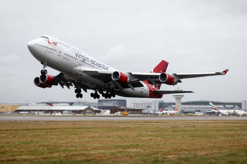 A Boeing Co. 747 passenger aircraft, operated by Virgin Atlantic Airways Ltd takes off at London Gatwick Airport in Crawley, U.K., on Tuesday, Jan. 10, 2017. Discount airlines are piling on passengers using bargain-basement pricing even as a sluggish economy and the threat of terror attacks clips demand. Photographer: Simon Dawson/Bloomberg