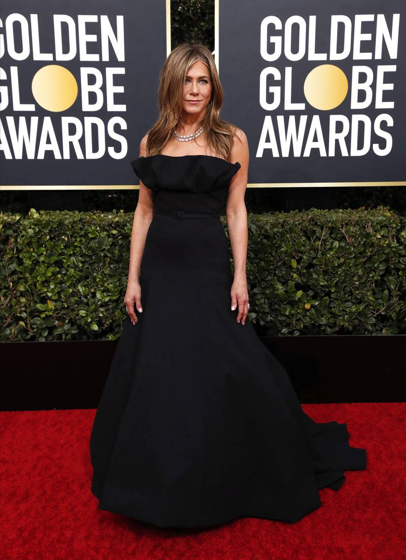 epa08105894 Jennifer Aniston arrives for the 77th annual Golden Globe Awards ceremony at the Beverly Hilton Hotel, in Beverly Hills, California, USA, 05 January 2020. Dress by Dior. EPA-EFE/NINA PROMMER