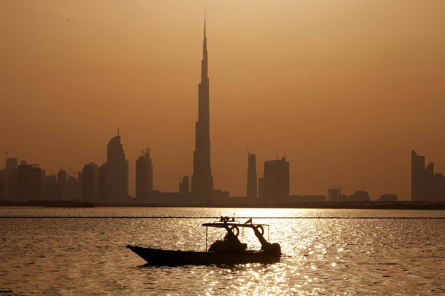 A coast guard boat patros the waters of the Ras Al Khor nature reserve with a view of the Burj Khalifa and downtown in Dubai on April 9, 2012. Christopher Pike / The National