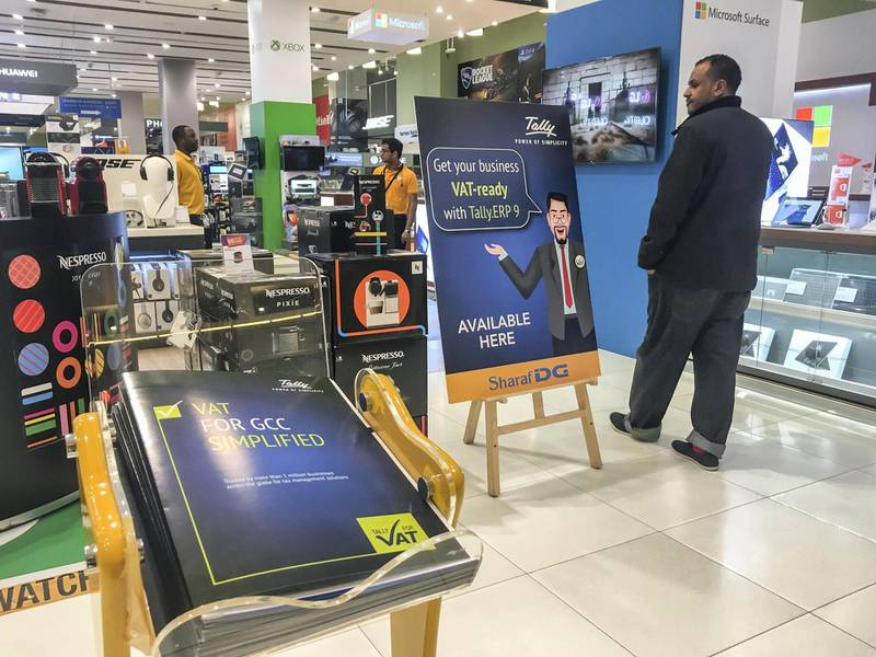 DUBAI, UNITED ARAB EMIRATES. 21 DECEMBER 2017. Shopping in Dubai Mall before the implementation of VAT across the UAE. VAT Signage at SharafDG stores. (Photo: Antonie Robertson/The National) Journalist: None. Section: National.