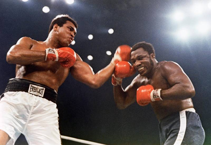 Muhammad Ali, left, and Joe Frazier are shown in action in the 12-round non-title fight that took place at Madison Square Garden in New York, Jan. 28, 1974. (AP Photo)