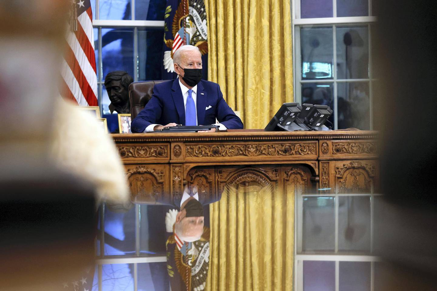 U.S. President Joe Biden signs executive orders on immigration reform inside the Oval Office at the White House in Washington, U.S., February 2, 2021. REUTERS/Tom Brenner