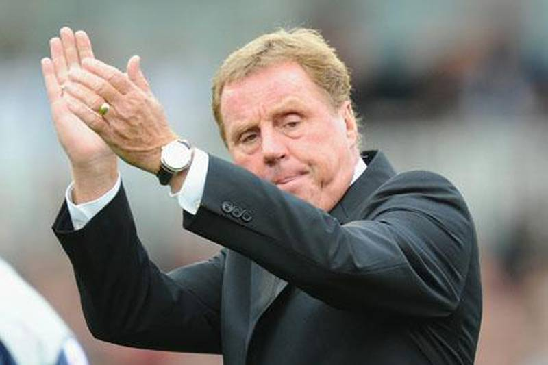 LONDON, ENGLAND - OCTOBER 16:  Tottenham manager Harry Redknapp salutes the fans during the Barclays Premier League match between Fulham and Tottenham Hotspur at Craven Cottage on October 16, 2010 in London, England.  (Photo by Mike Hewitt/Getty Images)