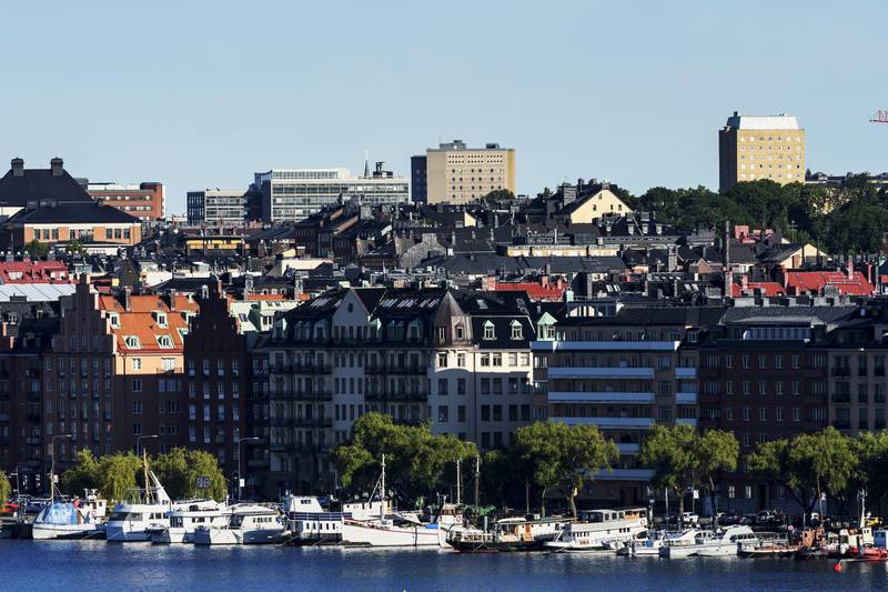 Residential apartment blocks stand near vessels on the waterfront in the Norrmlarstrand district of Stockholm, Sweden, on Wednesday, June 28, 2017. Just as Sweden's biggest mortgage banks start raising interest rates, the country's state-backed home-loan provider says it's cutting customers' borrowing costs in a move that threatens to hurt industry profits after years of negative rates. Photographer: Mikael Sjoberg/Bloomberg