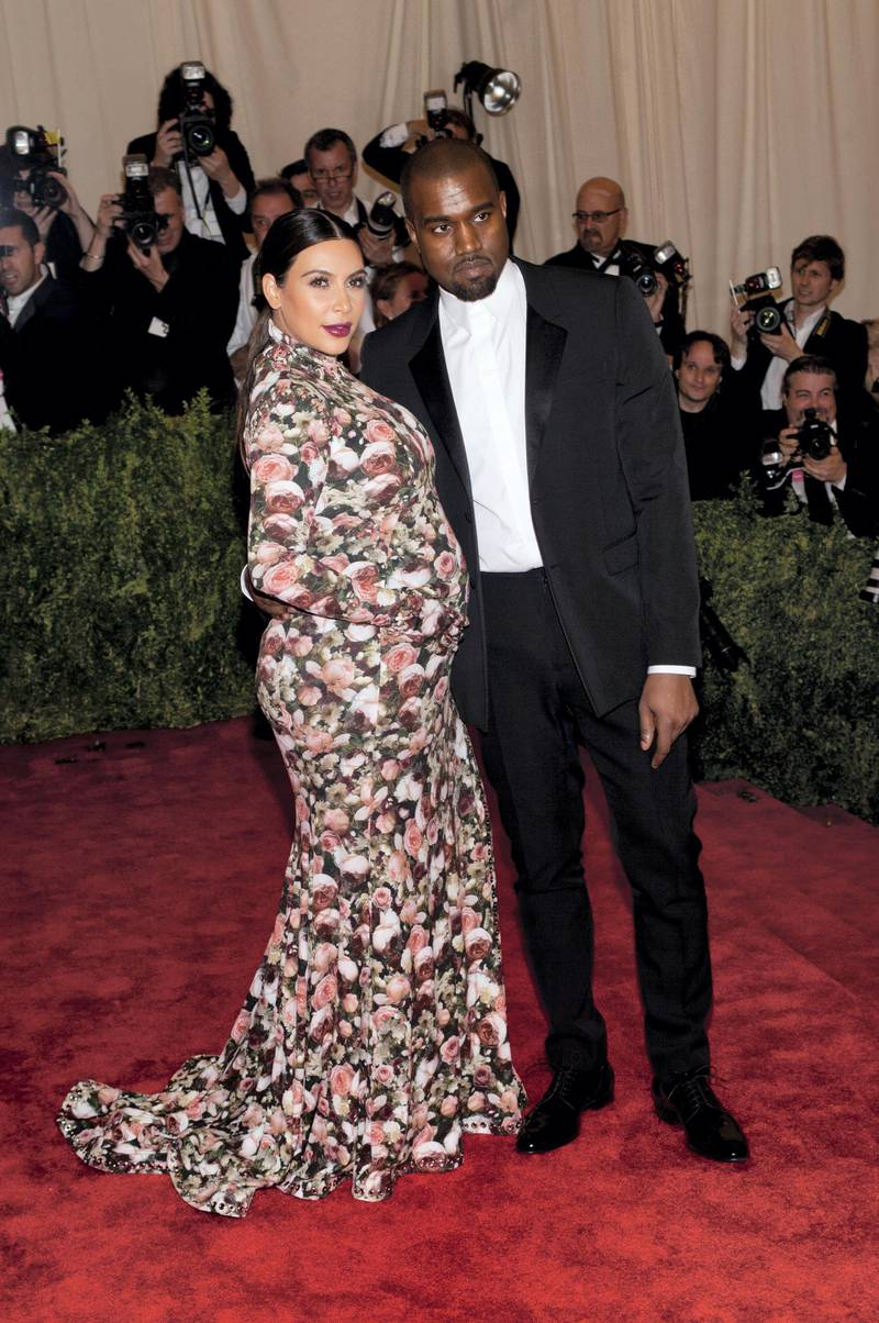 Kanye West and Kim Kardashian attend the Costume Institute Gala for the 'PUNK: Chaos to Couture' exhibition at the Metropolitan Museum of Art in New York City.  LAN (Photo by Lars Niki/Corbis via Getty Images)