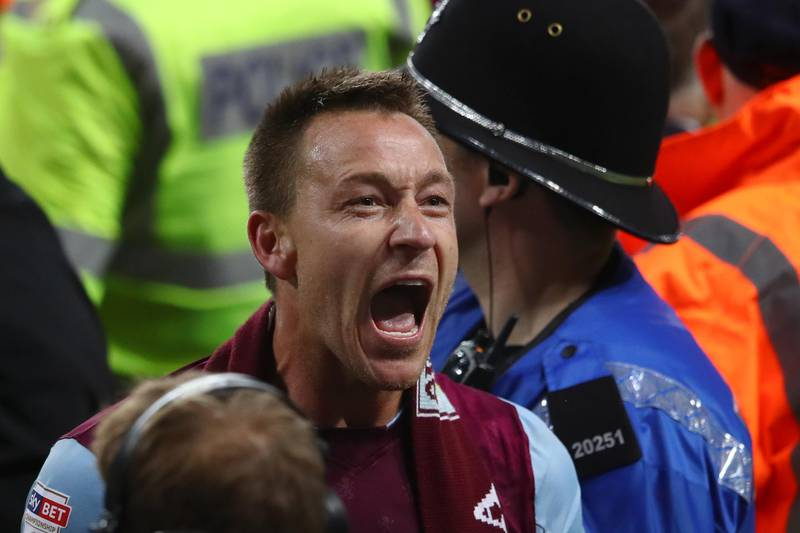 BIRMINGHAM, ENGLAND - MAY 15:  John Terry of Aston Villa celebrates at the full time whistle during the pitch invasion during the Sky Bet Championship Play Off Semi Final second leg match between Aston Villa and Middlesbrough at Villa Park on May 15, 2018 in Birmingham, England.  (Photo by Clive Mason/Getty Images)