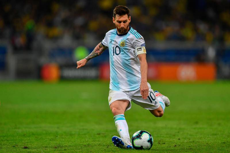 (FILES) In this file photo taken on July 02, 2019, Argentina's Lionel Messi strikes the ball during the Copa America football tournament semi-final match against Brazil at the Mineirao Stadium in Belo Horizonte, Brazil.  Messi will once again hold the baton for Argentina on its way to the World Cup Qatar 2022 football tournament, in the debut of the South American Qualification Round with Ecuador, a team that is usually a box of surprises. / AFP / Pedro UGARTE