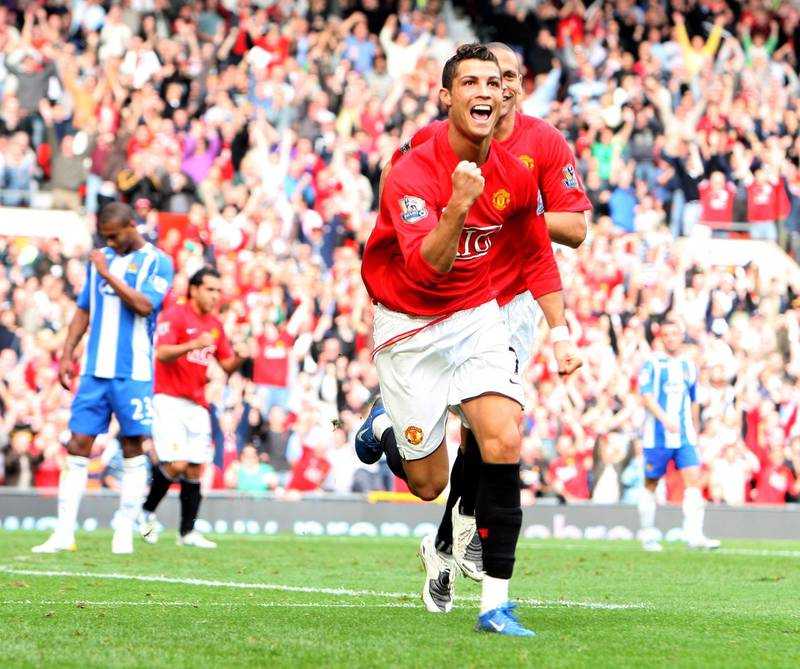 MANCHESTER, UNITED KINGDOM - OCTOBER 06:  Cristiano Ronaldo of Manchester United scores against Wigan Athletic during the Barclays Premier League match between Manchester United and Wigan Athletic at Old Trafford on October 06, 2007 in Manchester, England.  (Photo by Phil Cole/Getty Images)