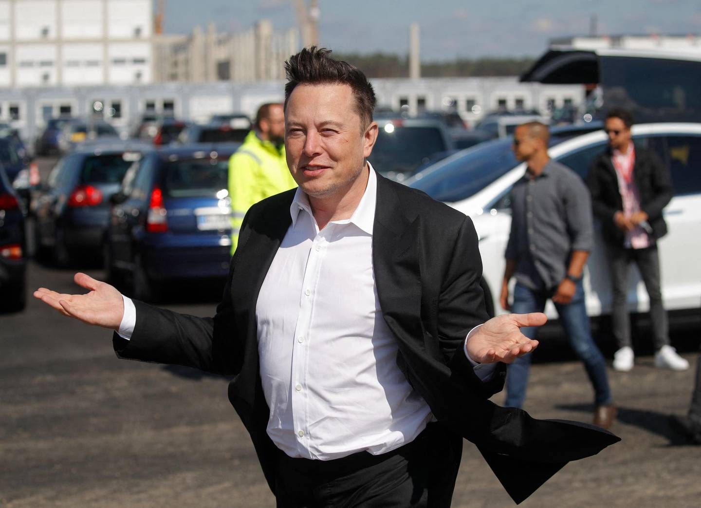 (FILES) In this file photo taken on September 3, 2020 Tesla CEO Elon Musk gestures as he arrives to visit the construction site of the future US electric car giant Tesla, in Gruenheide near Berlin. This week, Tesla boss Elon Musk criticized bitcoin's power consumption, particularly of energy produced from coal, and said he would no longer accept the cryptocurrency as payment for his electric cars. / AFP / Odd ANDERSEN