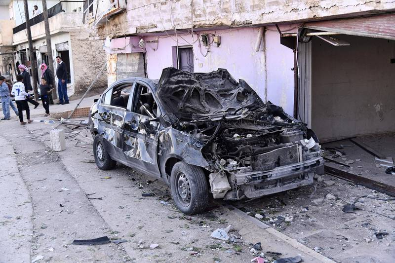 """A handout picture released by the official Syrian Arab News Agency (SANA) on November 20, 2019 shows the wreckage of a car at the scene of a reportedly Israeli air strike in the Syrian village of Beit Saber, southwest of the capital Damascus. - The Israeli army confirmed that it carried out strikes against military sites in Damascus, in response to rocket fire from Syria the previous day. """"We just carried out wide-scale strikes of Iranian Quds Force & Syrian Armed Forces targets in Syria in response to the rockets fired at Israel by an Iranian force in Syria,"""" the Israel Defense Forces tweeted. Syria's state media earlier said Syrian anti-aircraft defences intercepted a """"heavy attack"""" by Israeli warplanes over the capital Damascus. (Photo by - / SANA / AFP)"""