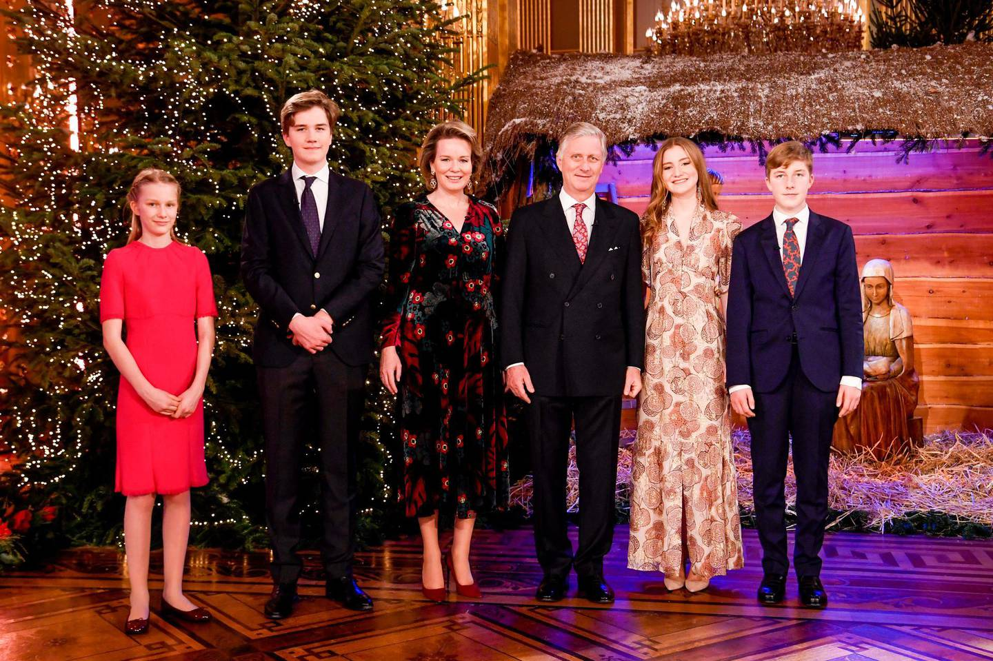 """BRUSSELS, BELGIUM - DECEMBER 17: Princess Eléonore of Belgium, Prince Gabriel, Queen Mathilde, King Philippe of Belgium, Princess Elisabeth and Prince Emmanuel pose in front of the Christmas Crib prior to attending the Christmas Concert by the Scala Choir at the Royal Palace on December 17, 2020 in Brussels, Belgium. The throne room is decorated with a Christmas """"veil of origamis"""" conceived by designer Charles Kaisin. (Photo by Frédéric Sierakowski - Royal Belgium Pool/Getty Images) (Photo by Frédéric Sierakowski - Royal Belgium Pool/Getty Images)"""