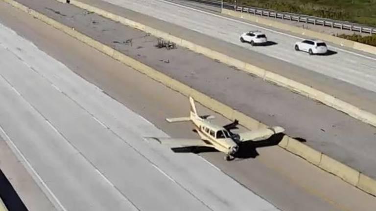 An image that illustrates this article Surveillance footage shows plane landing on motorway in Toronto