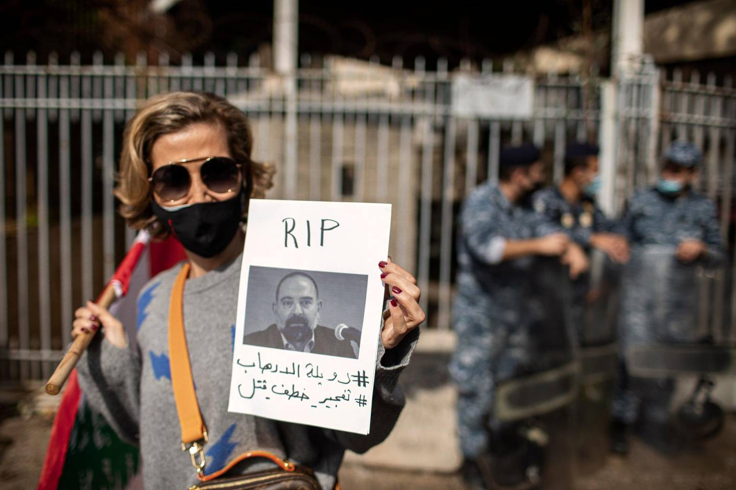 BEIRUT, LEBANON - FEBRUARY 4: A Lebanese protesterdemands justice after the assassination of Lokman Slim, a prominent Hezbollah critic, who was reportedly found shot dead in his car in South Lebanon on February 4, 2021 in Beirut, Lebanon.  (Photo by Diego Ibarra Sanchez/Getty Images)