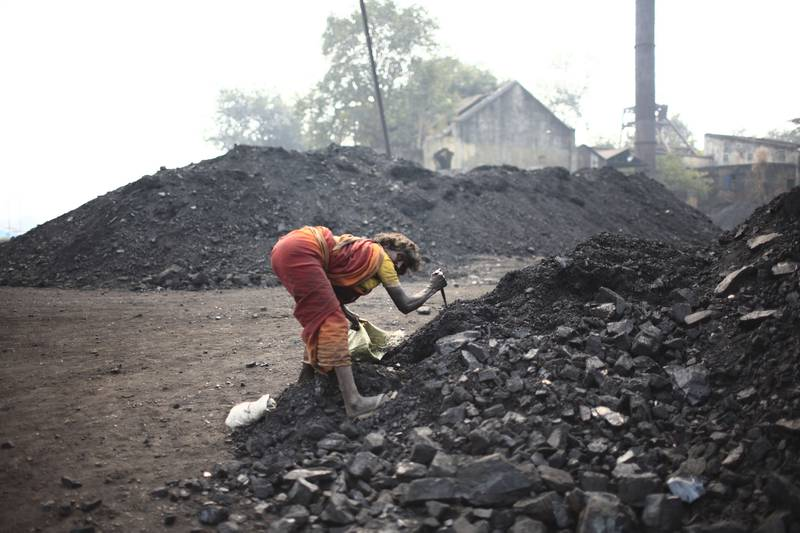 Jharia - Dec. , 2009 - A local woman steals coal from the Government Coal   storage depot at Jharia. (Subhash Sharma for The National)