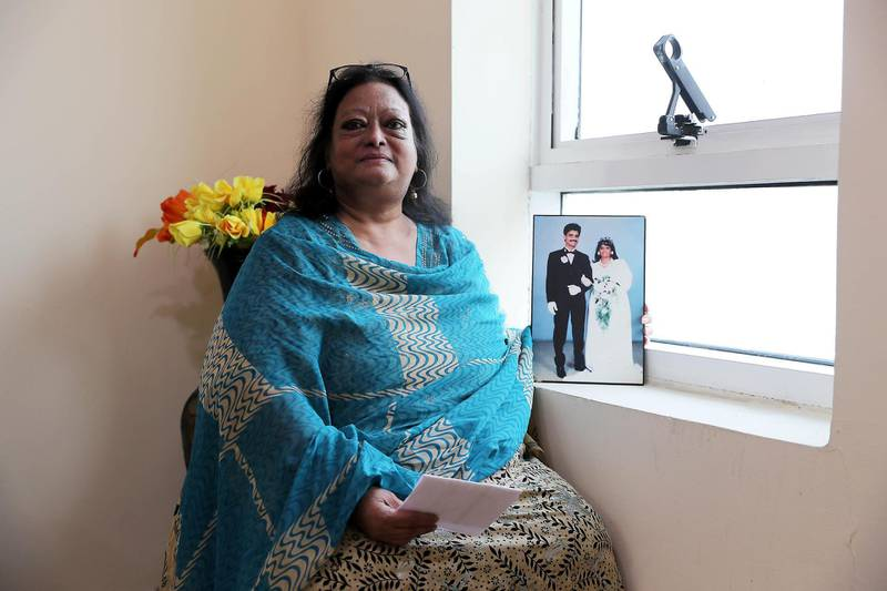 SHARJAH , UNITED ARAB EMIRATES ,  November 6 , 2018 :- Pricilla Helen Aden with the photo of her Late husband at her home in Sharjah. She got her new six-month residency visa during the amnesty period.  ( Pawan Singh / The National )  For News. Story by Ramola