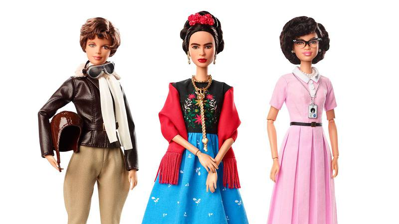 This product image released by Barbie shows dolls in the image of pilot Amelia Earhart, left, Mexican artist Frida Khalo and mathematician Katherine Johnson, part of the Inspiring Women doll line series being launched ahead of International Women's Day. (Barbie via AP)