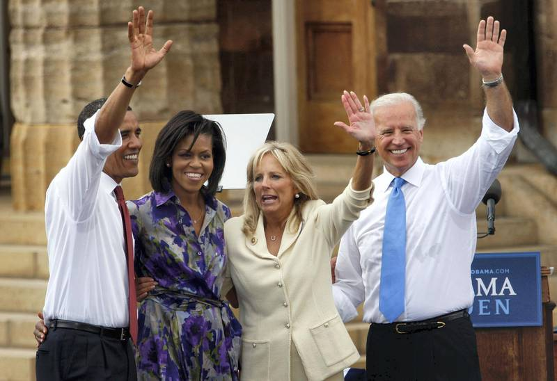 US Democratic presidential candidate Illinois Senator Barack Obama (L), his wife Michelle, running mate Delware Senator Joe Biden (R) with his wife Jill greet people gathered on the lawn of the Old State Capitol on August 23, 2008 in Springfield, Illinois. The Obama campaign confirmed this morning Biden had been selected as Obama's running mate.          AFP PHOTO/Scott Olson/Getty Images             FOR NEWSPAPERS, INTERNET, TELCOS AND TELEVISION USE ONLY