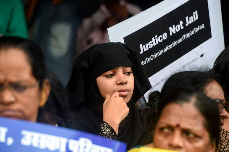 """Women take part in a protest against the recent passage of a law to criminalise """"instant divorce"""" for Muslims in Mumbai on August 1, 2019. The Indian government and women's groups hailed """"historic"""" legislation July 31 that criminalised """"instant divorce"""" for Muslims, but an influential Islamic group said it would launch a legal challenge.  / AFP / PUNIT PARANJPE"""