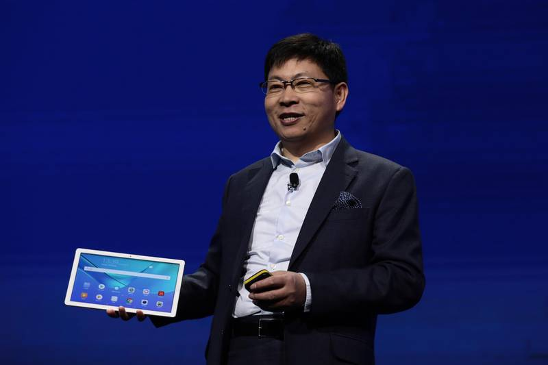 Richard Yu, chief executive officer of Huawei Technologies Co., presents the MediaPad M5 tablet device during the company's launch event ahead of the Mobile World Congress (MWC) in Barcelona, Spain, on Sunday, Feb. 25, 2018. At the wireless industry's biggest conference, more than 100,000 people are set to see the latest smartphones, artificial intelligence devices and autonomous drones exhibited by roughly 2,300 companies. Photographer: Simon Dawson/Bloomberg