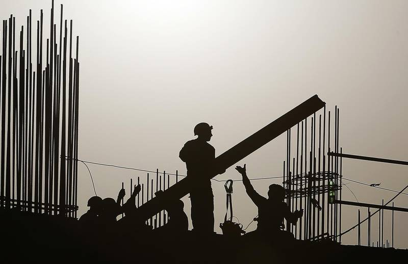 DUBAI, UNITED ARAB EMIRATES , July 5 – 2020 :- Labourers working at one of the construction site during the sunset in Dubai. (Pawan Singh / The National) For News/Standalone/Online/Stock/Instagram