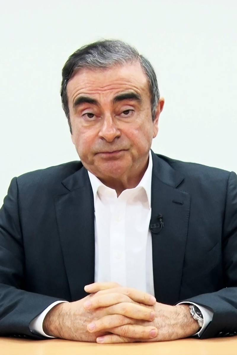 """(FILES) This file screen grab from a handout video by representatives of former Nissan chief Carlos Ghosn dated April 9, 2019 shows the 65-year-old tycoon speaking in a video message recorded before his rearrest earlier this year in Tokyo. Ghosn said on December 31, 2019 he had fled to Lebanon to escape injustice in Japan, where he was on bail awaiting trial on financial misconduct charges. The auto tycoon's abrupt departure was the latest twist in a rollercoaster journey that saw him fall from boardroom to detention centre and it sparked questions over an embarrassing security lapse in Japan. He stands accused of two counts of under-reporting his salary to the tune of 9.23 billion yen ($85 million) from 2010 to 2018, deferring some of his pay and failing to declare this to shareholders. - -----EDITORS NOTE --- RESTRICTED TO EDITORIAL USE - MANDATORY CREDIT """"AFP PHOTO / Representatives for Carlos Ghosn"""" - NO MARKETING - NO ADVERTISING CAMPAIGNS - DISTRIBUTED AS A SERVICE TO CLIENTS  / AFP / Representatives for Carlos Ghosn  / Handout / -----EDITORS NOTE --- RESTRICTED TO EDITORIAL USE - MANDATORY CREDIT """"AFP PHOTO / Representatives for Carlos Ghosn"""" - NO MARKETING - NO ADVERTISING CAMPAIGNS - DISTRIBUTED AS A SERVICE TO CLIENTS"""